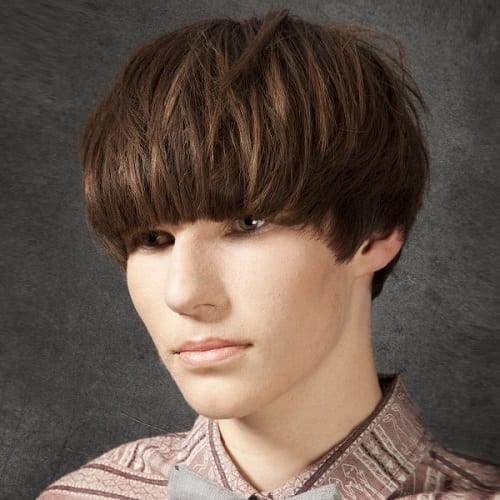 A bowl-cut hairstyle man