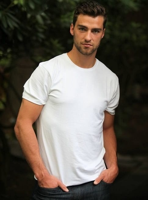 A man in a white t-short and cool hairstyle