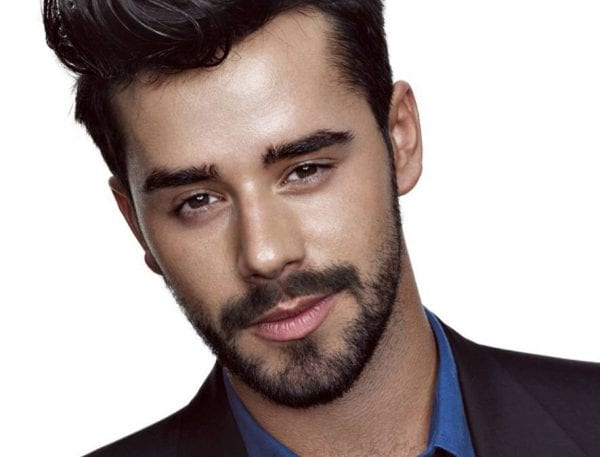 A guy with a large snout facial hairstyle