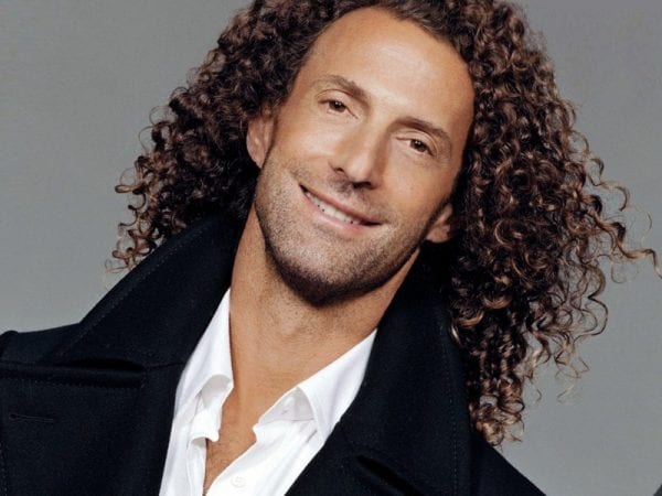 A man with a curly hairstyle