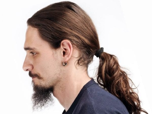 A fellow with a ponytail hairstyle and goatee