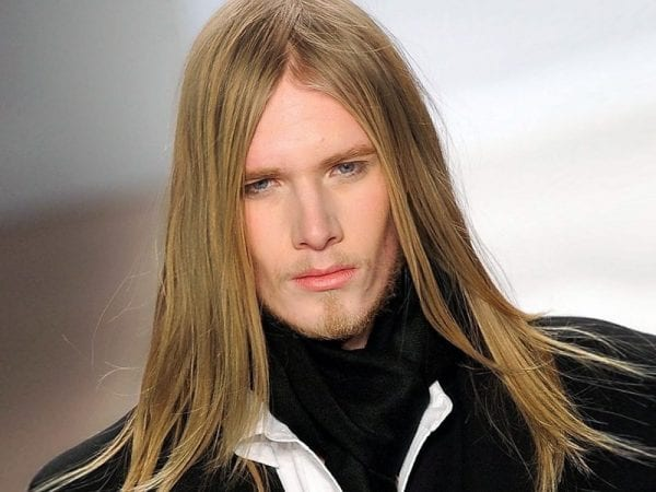 A guy with a straight long hairstyle