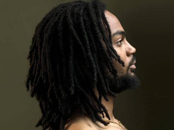 A black man with a dreadlocks hairstyle
