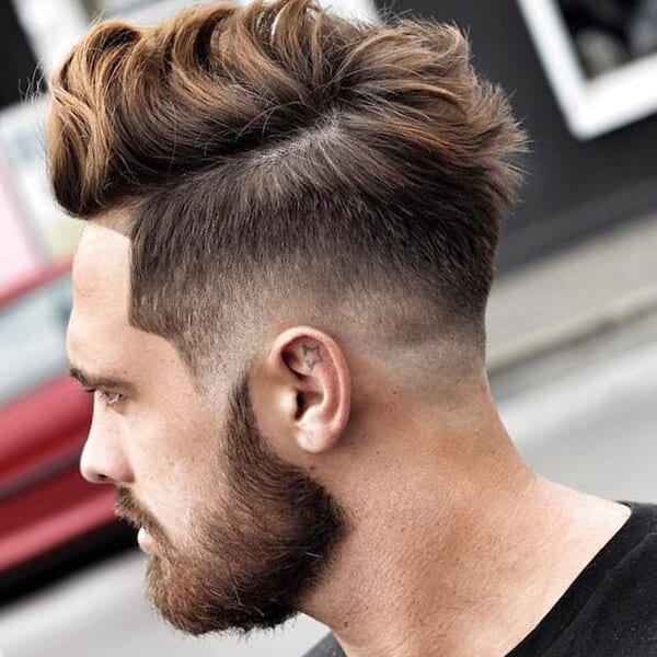 Pompadour-inspired undercut hairstyle for men