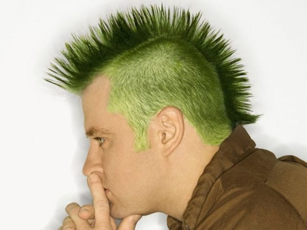 A green-hair man with mohawk hairstyle