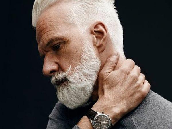 A grey-hair man with a beard