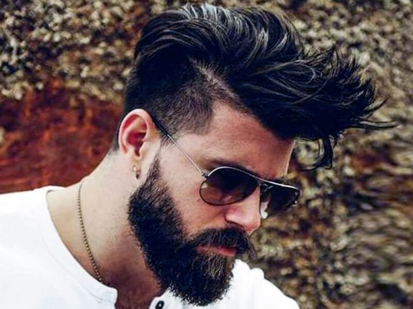 A hipster with beard and sunglasses