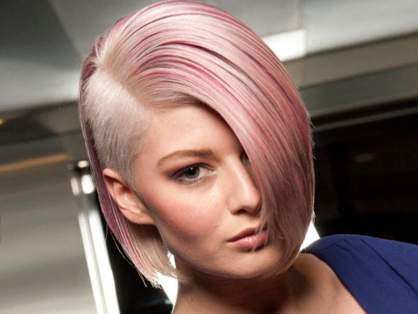 a woman with short pink hair