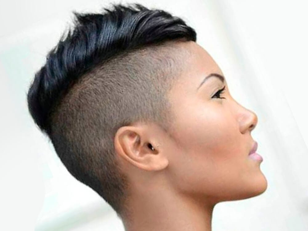 An Asian female with short Mohawk hairstyle.