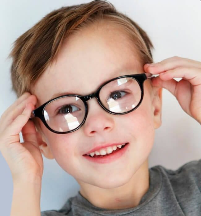 Sporty haircut for boys with glasses