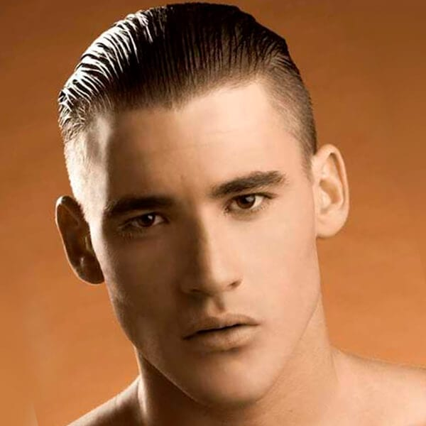 Slicked back men's undercut hairstyle