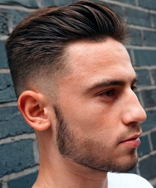 Slicked back undercut men's hairstyle, short