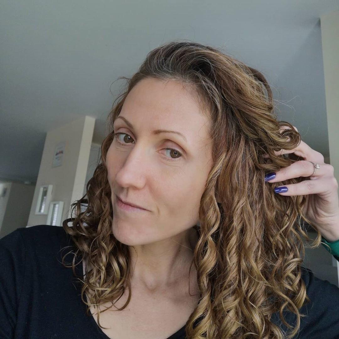 balayage long curled hairstyle