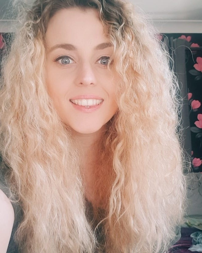 blonde curly haircut
