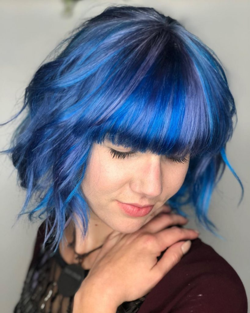 blue-color hairstyle with layers and bangs