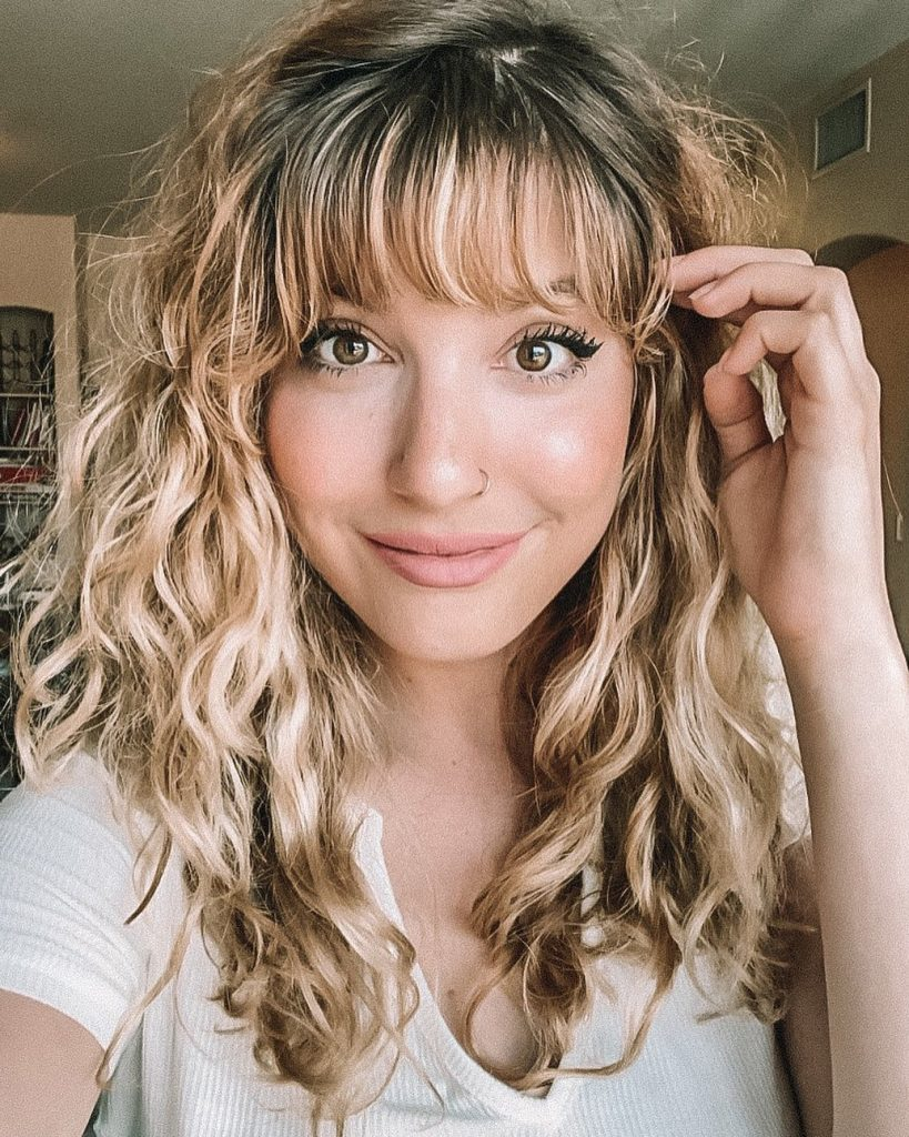 curled hairstyle with side-swept bangs