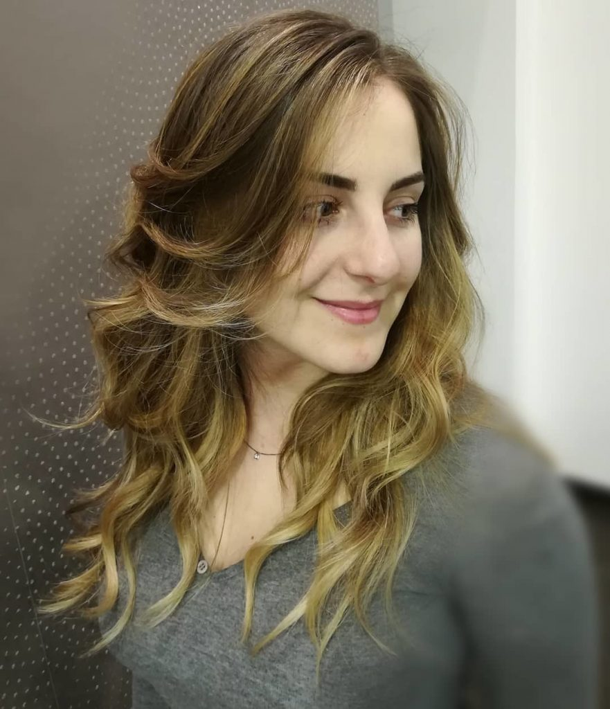 dirty blonde hair with wavy highlights