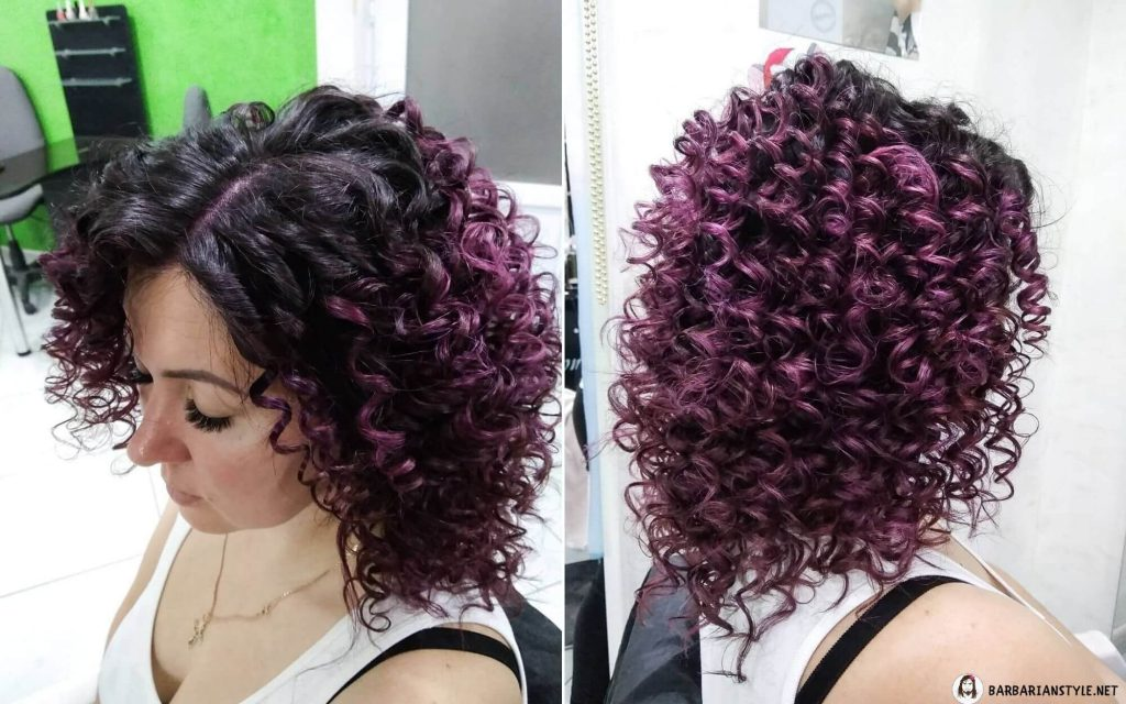 natural black hair with curly purple highlights