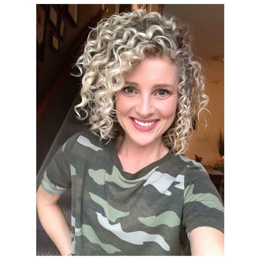 short curly blond haircut