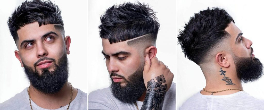 Disconnected Undercut Hair with an Acute Angled Fringe and a Beard