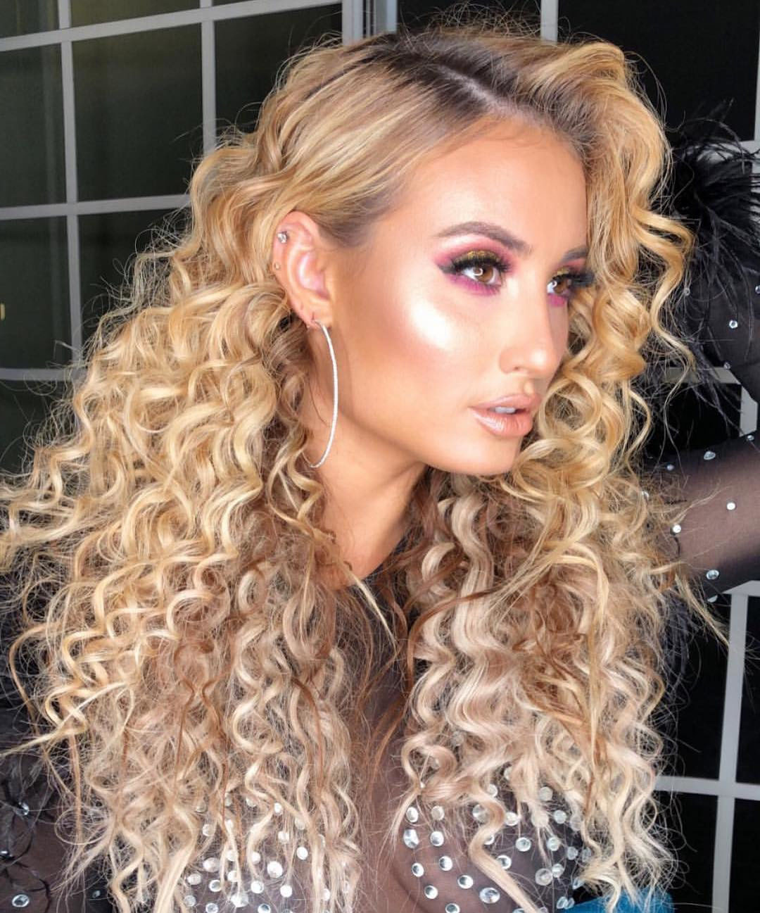 Long Hairstyle for Females with Blonde Curled Hair