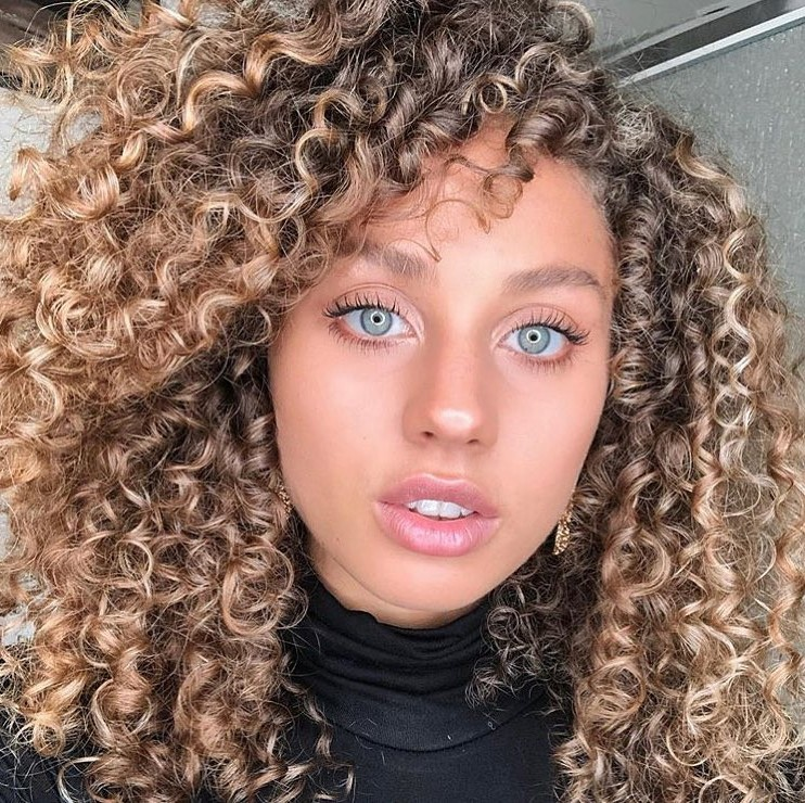 Medium-Length Hairstyle with Natural Afro Curls