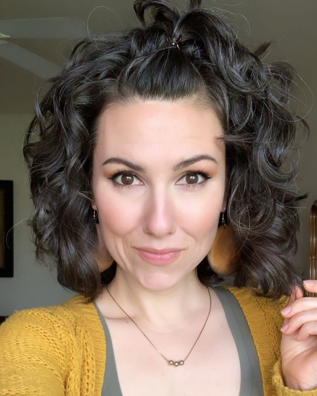 Short Curly Haircut for Black-Haired Females