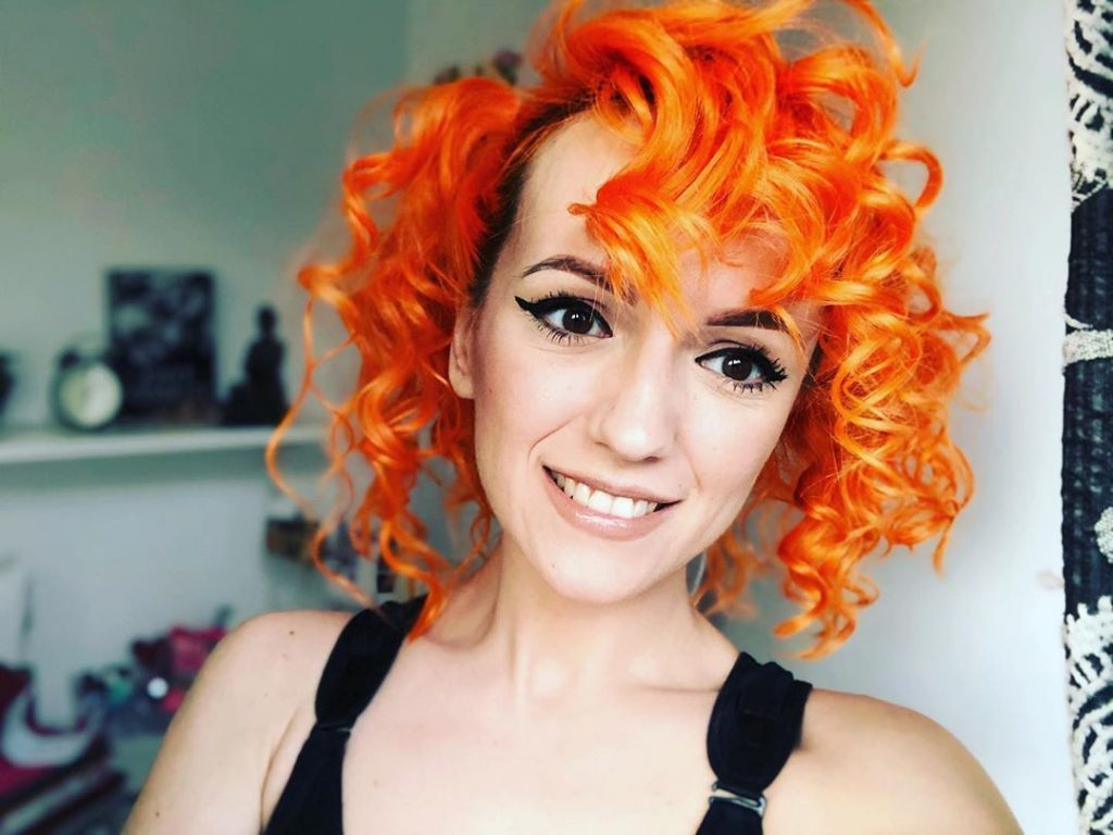 Short Orange Curly Hair with Bangs