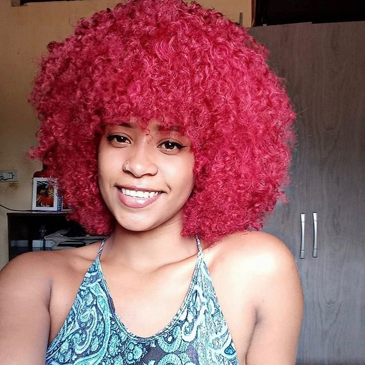 Shoulder-Length African American Hairstyle with Pink Curls