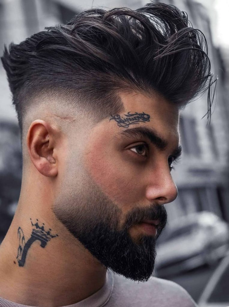 Slicked Back Hair with Fade Haircut and Thick Beard