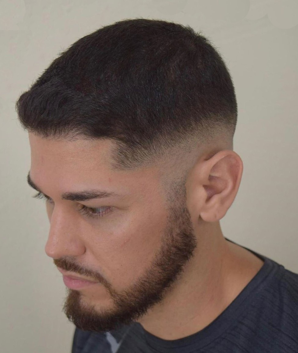 Trendy Haircut with a Beard and a Mustache