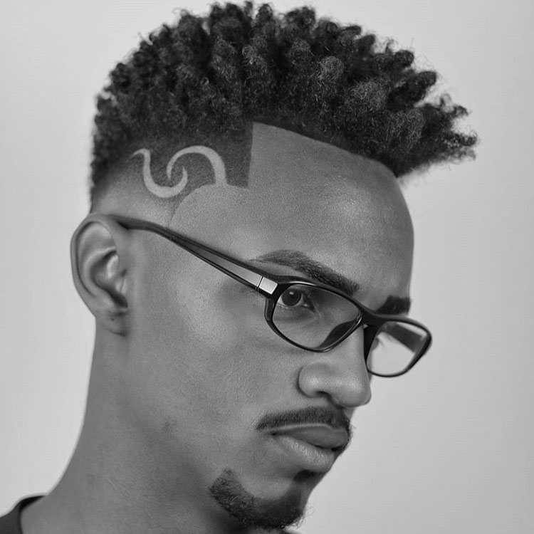 Black Men Natural Curly Hairstyle with Undercut Design