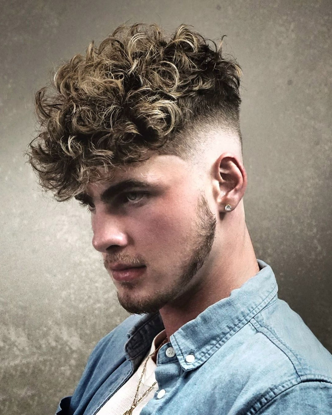 Curly Undercut Haircut with low Fade and Balbo Beard