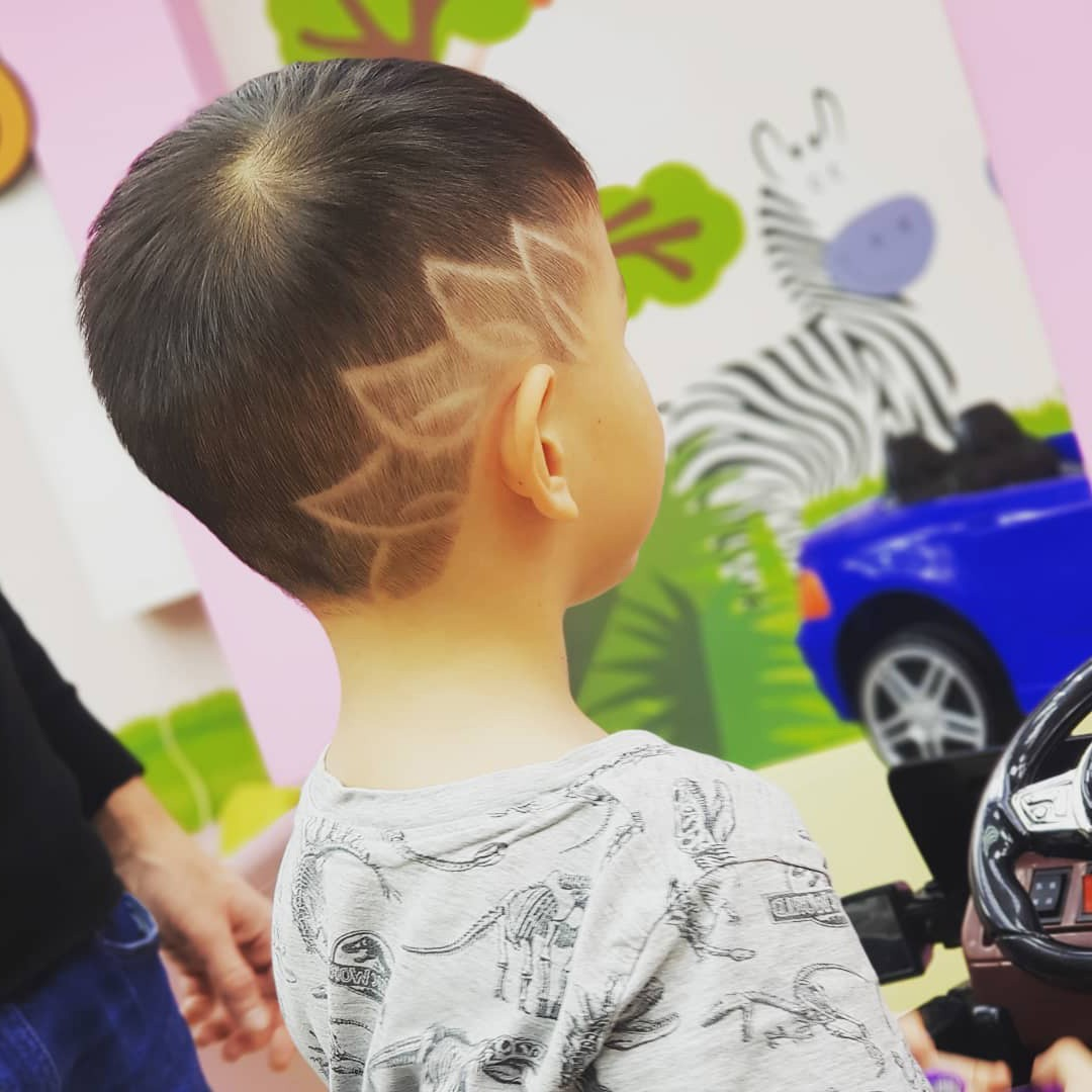 Cute Toddler Boy Haircut with Petal Design