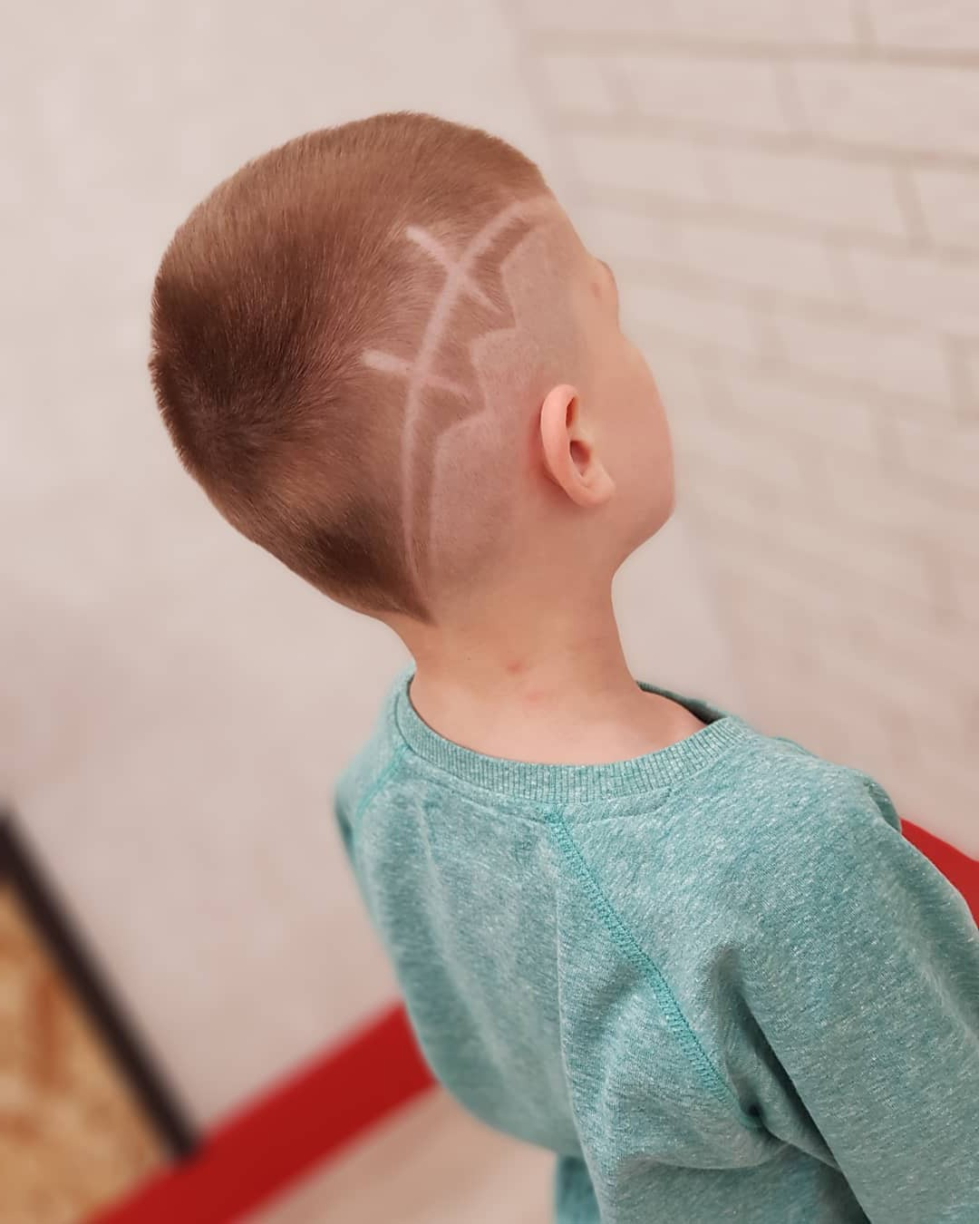 High Fade Undercut with Asymmetrical Lines for Boys