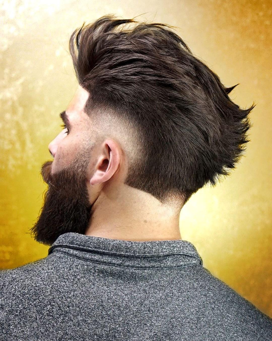 Long Brush Back Undercut Haircut with Low Fade and Full Beard