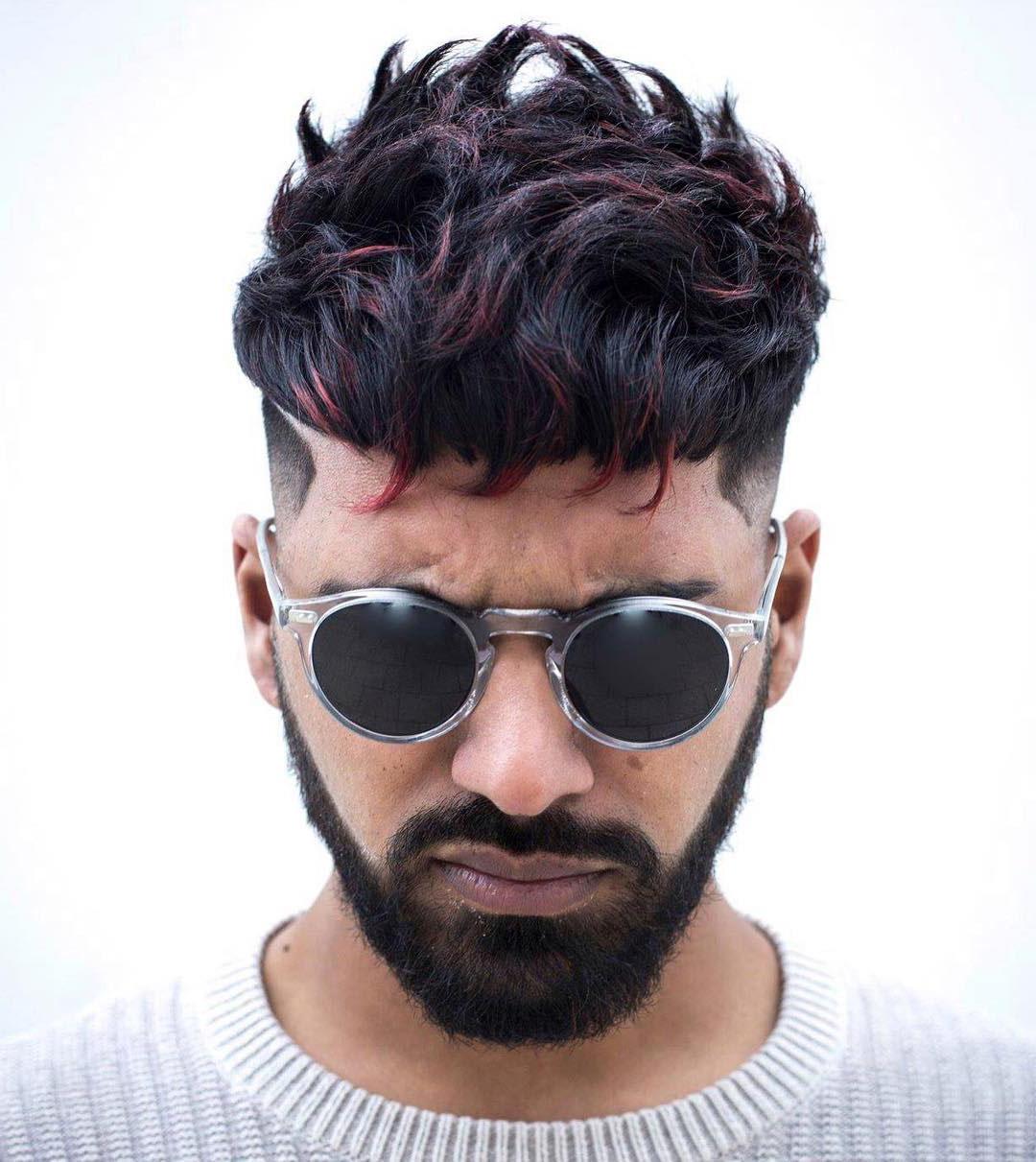 Short Curly Undercut Design with Full Beard