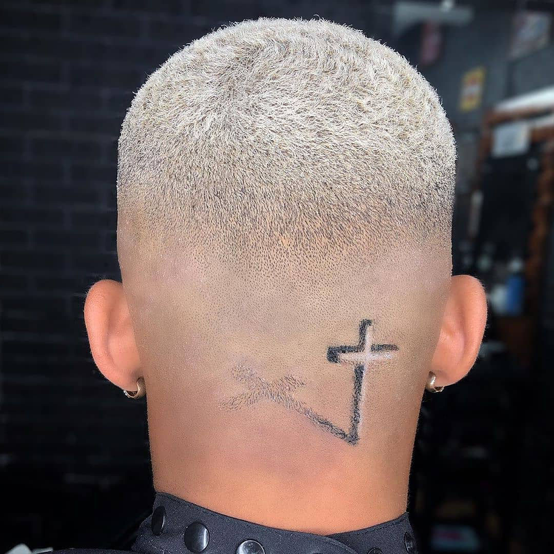 Skin Fade Undercut Design for Guys with Cross