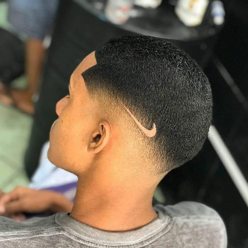 Undercut Fade Haircut with Nike Logo