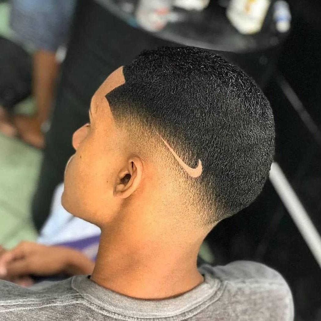 Undercut Fade Haircut with Nike Logo