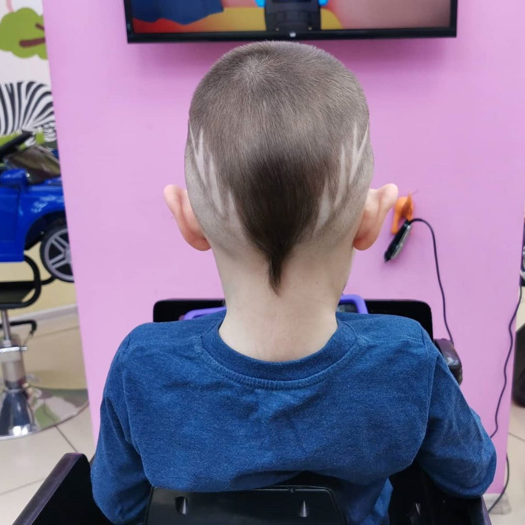 Undercut Hairstyle for Kids with Short Pigtail and Triangles