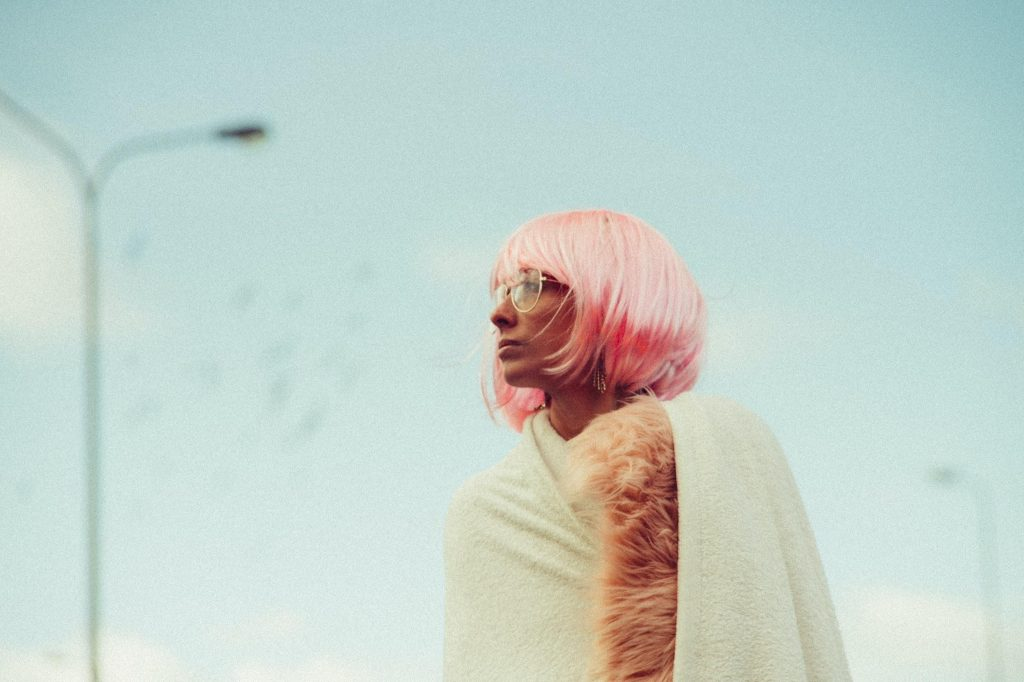 young girl with pink wigs and glasses