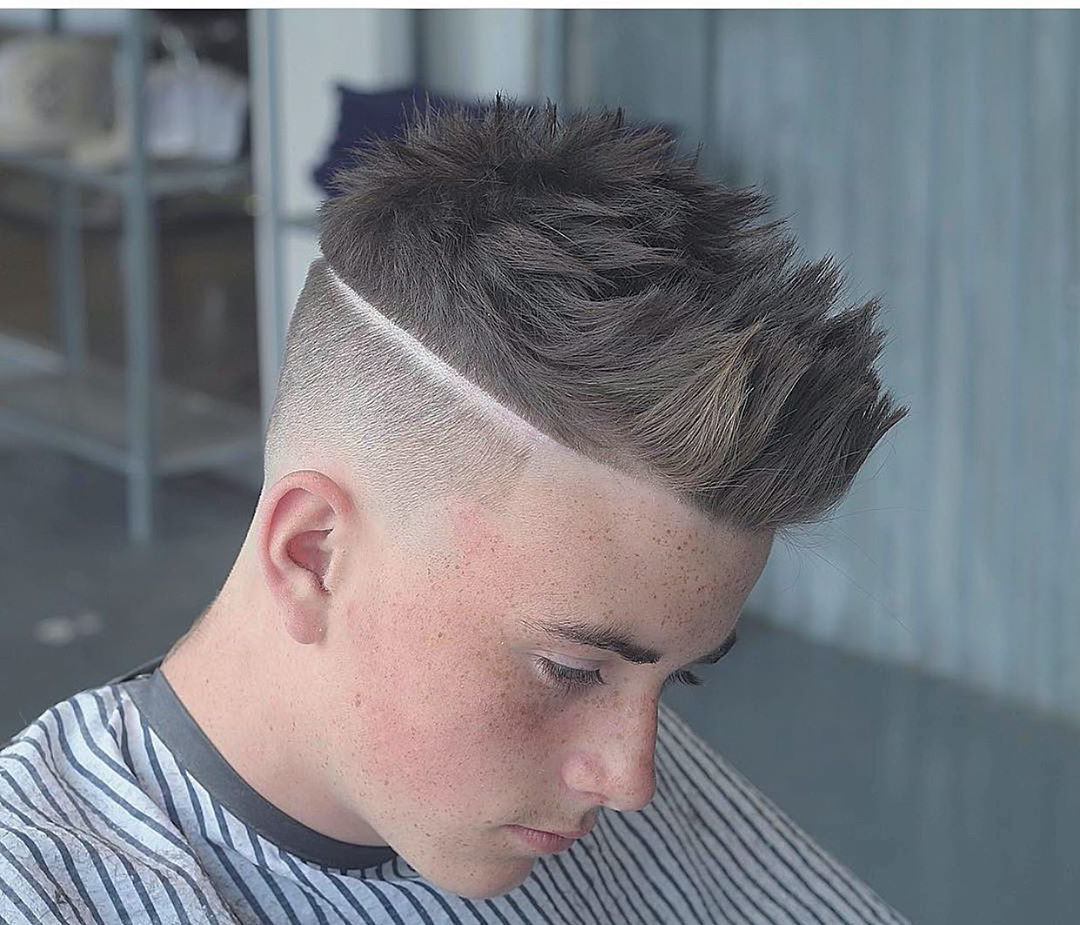 High Taper Fade Hairstyle for Guys with Spiky Top Hair