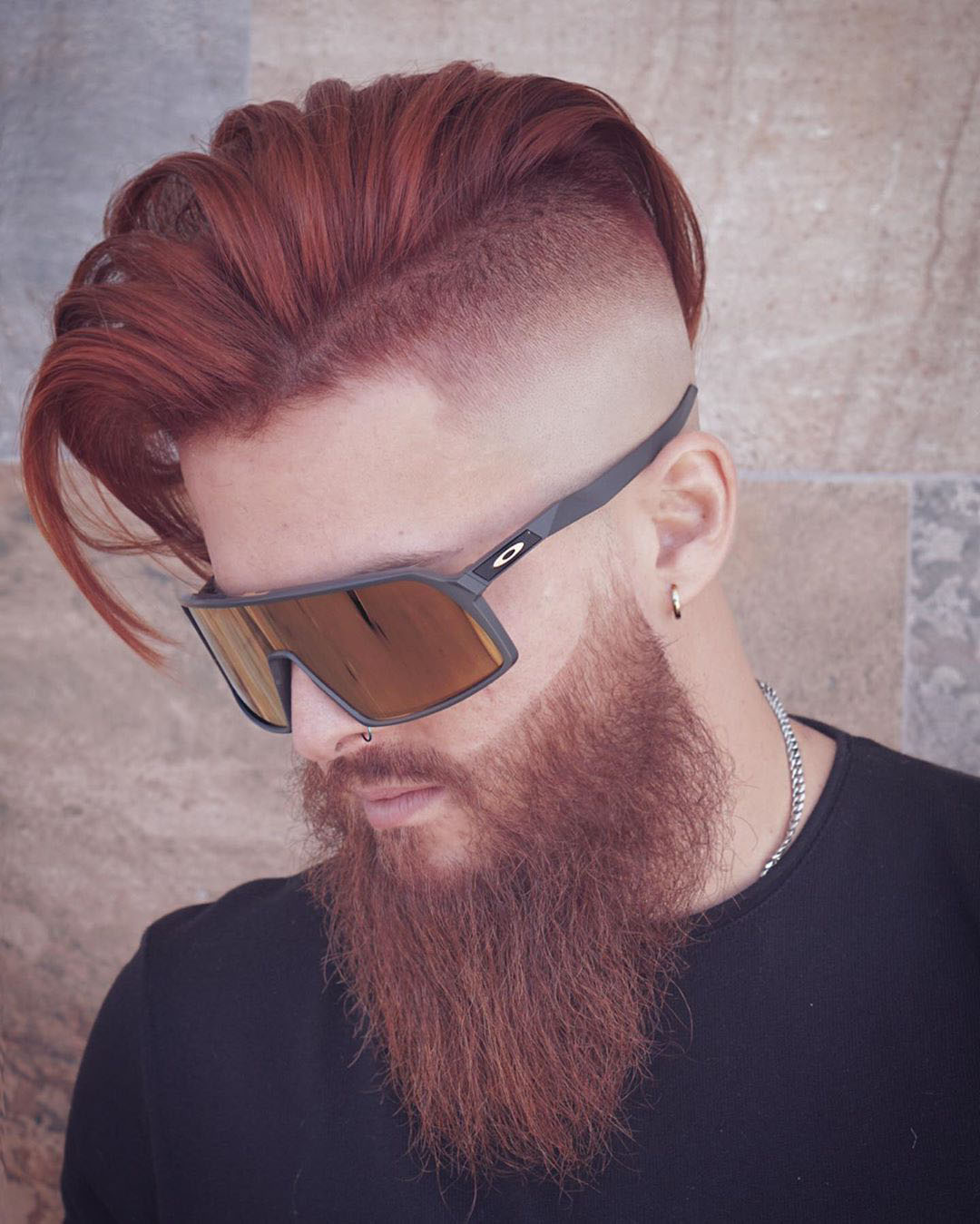 Side Swept Undercut Hairstyle with Long Beard
