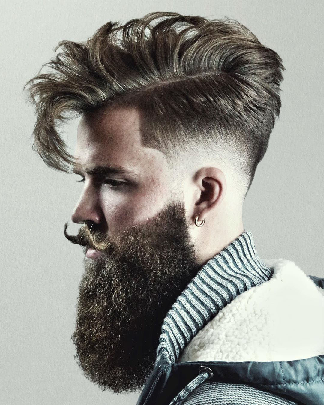 Undercut Hairstyle with Long Fringe and Beard