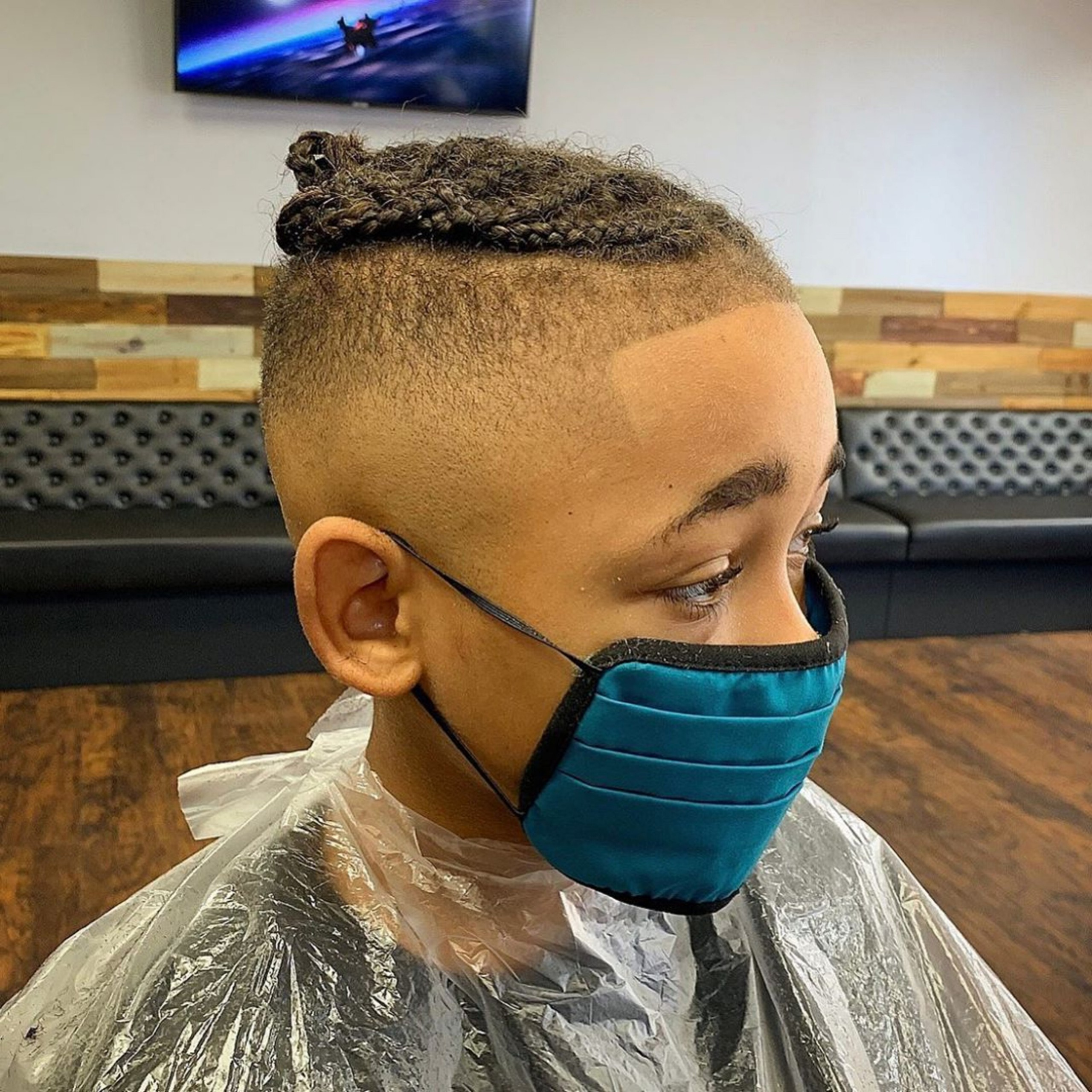 A faded haircut with braids for boys.