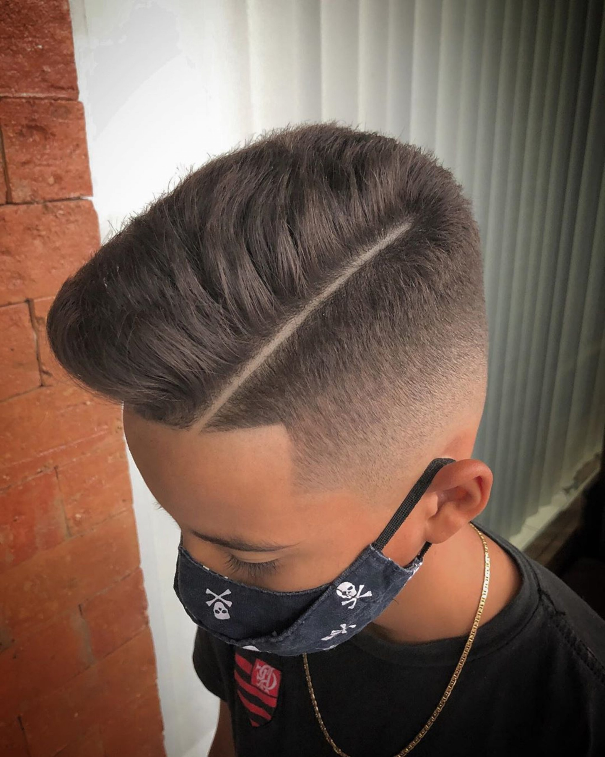 A comb-over faded haircut for boys.