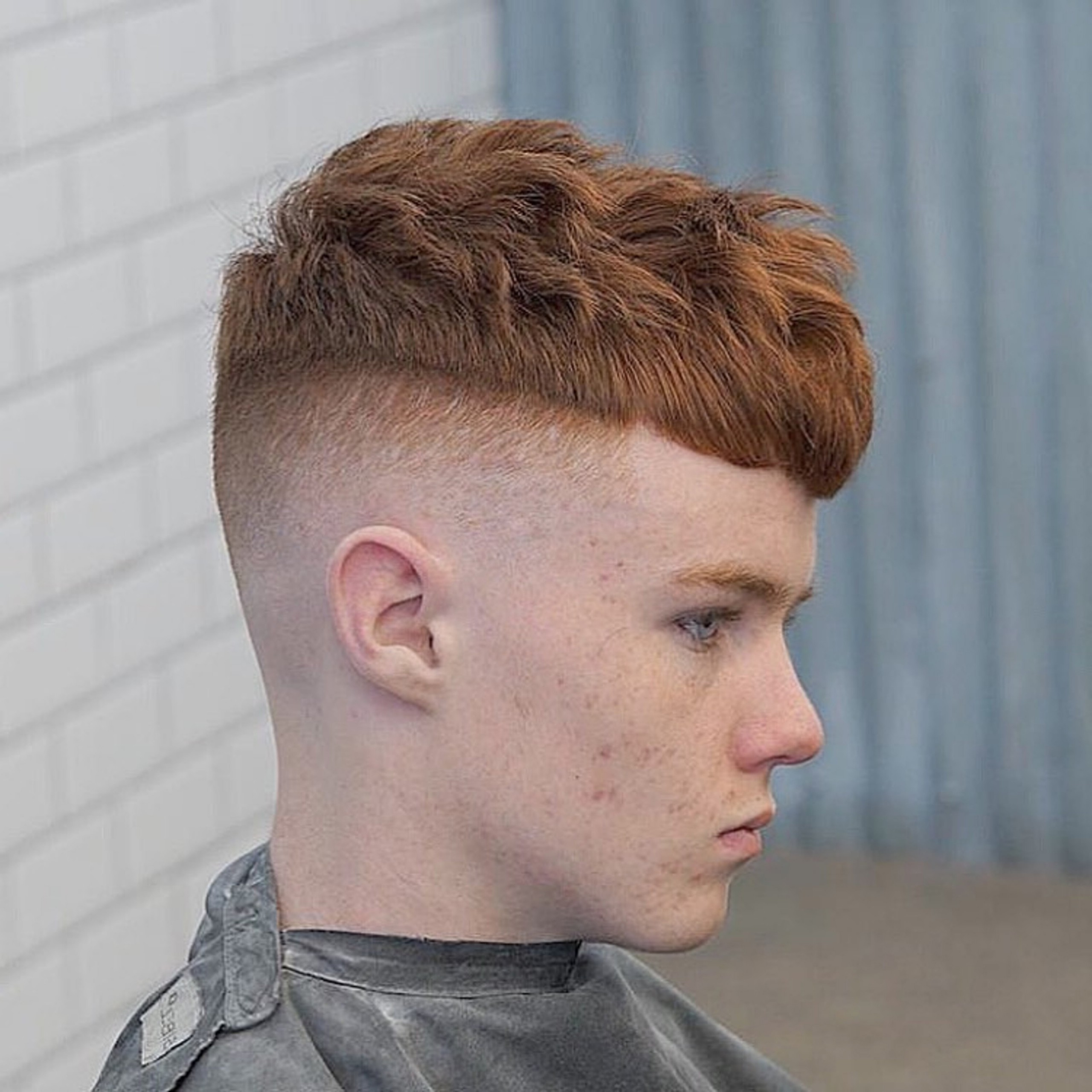A hairstyle with a faded transition for little boys.