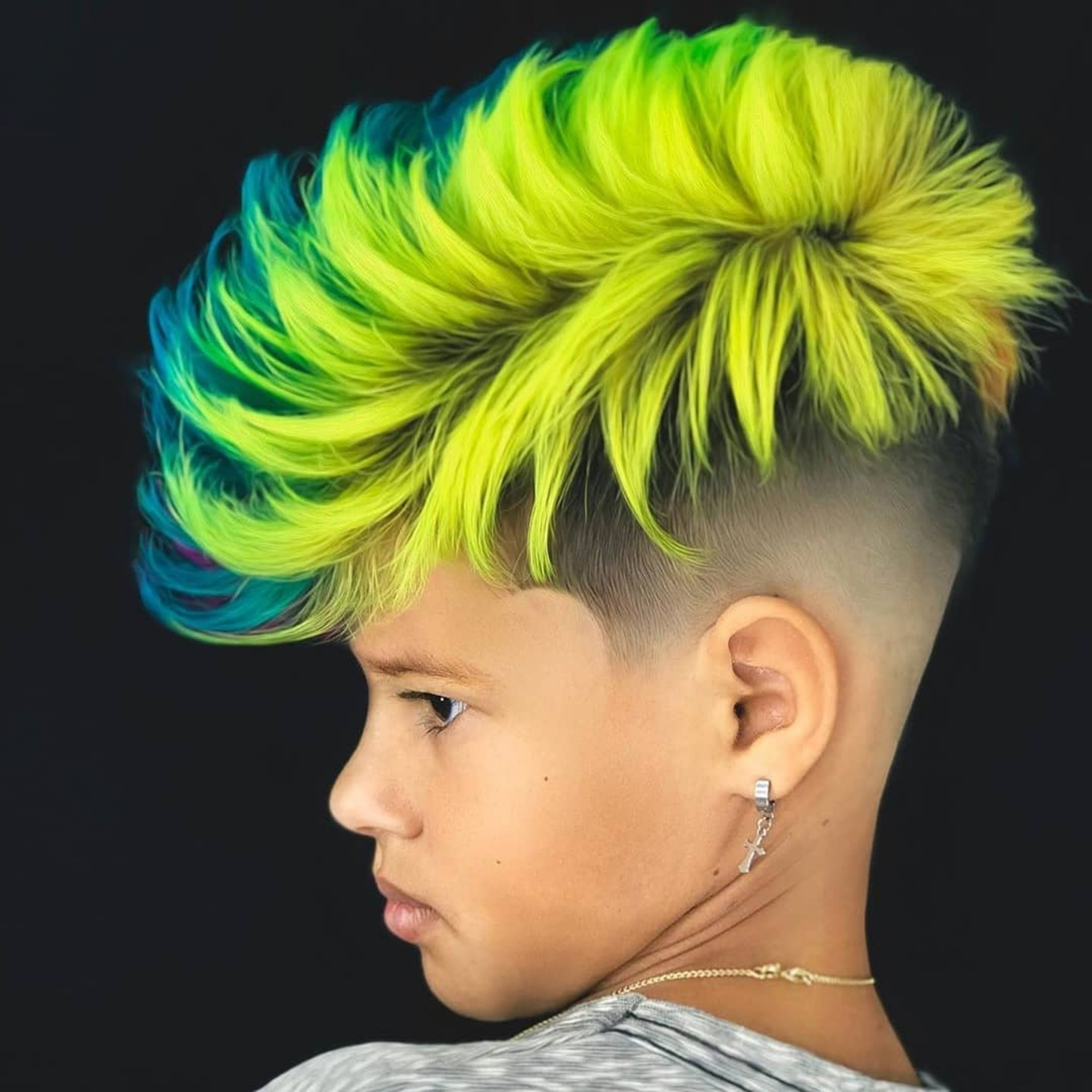 A Faded haircut with a Mohawk for boys.