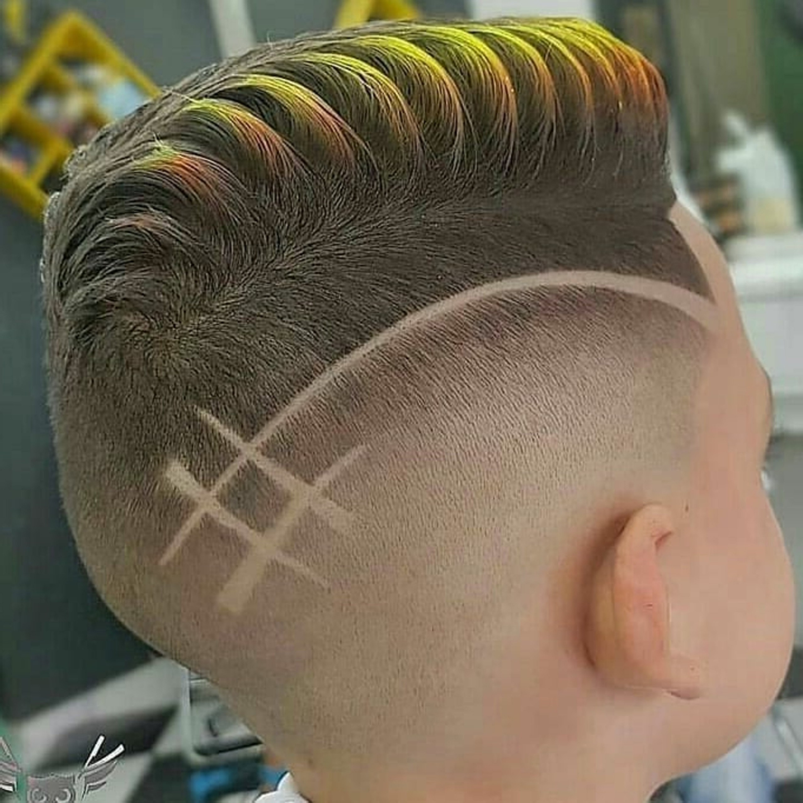 An unsual fade haircut for boys with a line.